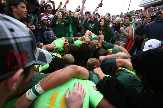 South Africa players celebrate after defeating New Zealand 14-7 in the cup final of the USA Sevens rugby tournament at Sam Boyd Stadium in Las Vegas on Sunday. (Chase Stevens/Las Vegas Review-Journal)