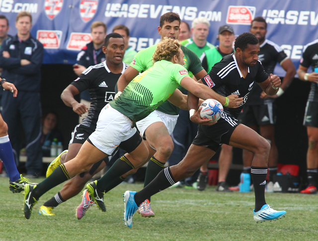 South Africa's Werner Kok reaches to tackle New Zealand's George Tilsley during the cup final of the USA Sevens rugby tournament at Sam Boyd Stadium in Las Vegas on Sunday. South Africa won 14-7 o ...