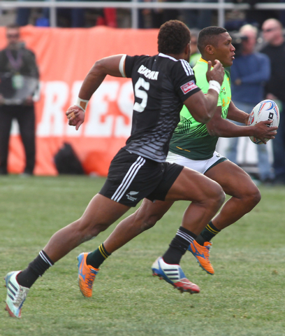 South Africa's Sampie Mastriet runs the ball against New Zealand's Lote Raikabula (5) during the cup final of the USA Sevens rugby tournament at Sam Boyd Stadium in Las Vegas on Sunday. South Afri ...