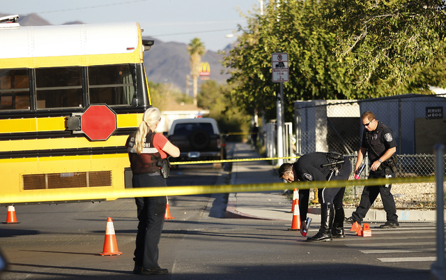 JASON BEAN/LAS VEGAS REVIEW-JOURNAL The North Las Vegas Police investigate an accident scene in which a 16 year old girl was struck by a Clark County School District bus next to Lincoln Elementary ...