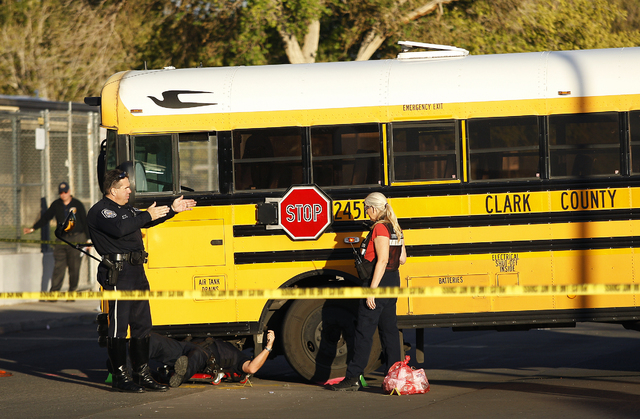 JASON BEAN/LAS VEGAS REVIEW-JOURNAL The North Las Vegas Police investigate an accident scene in which a 14 year old girl was struck by a Clark County School District bus next to Lincoln Elementary ...