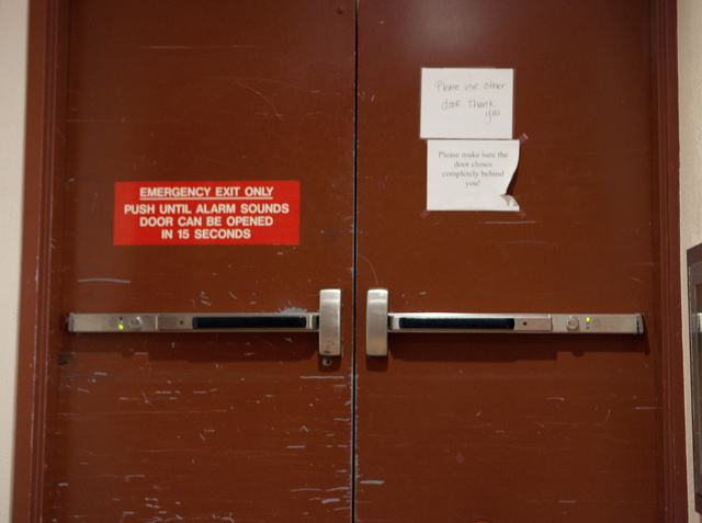 An alarmed door as seen on Friday, Jan. 3, 2014 at the south end of the Regional Justice Center. The door, which was broken for weeks, has now been repaired, officials said Friday. The broken door ...