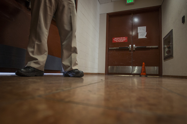 A security officer stands to the left of an alarmed door at the south end of the Regional Justice Center on Friday, Jan. 3, 2014. The door, which was broken for weeks, has now been repaired, offic ...