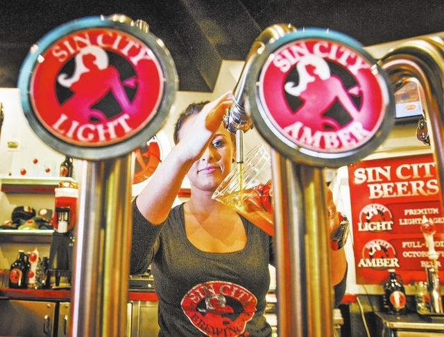 Egle Vaitiekute pours a beer at Sin City Brewery inside the Miracle Mile Shop at The Planet Hollywood, 3667 South Las Vegas  Boulevard, on Wednesday, Jan. 15, 2014.  Some businesses use the monike ...