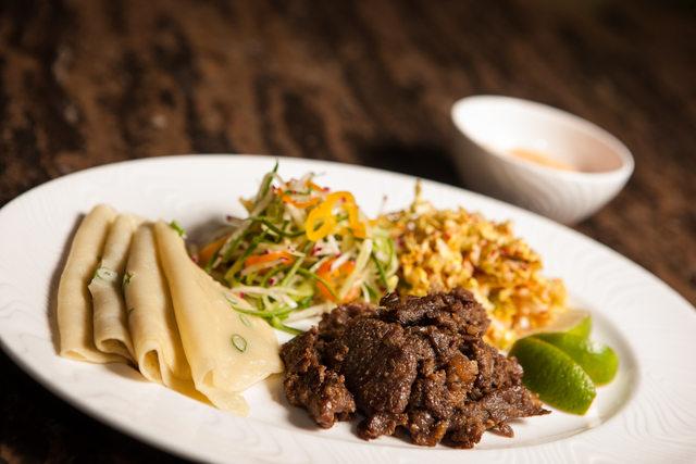 Korean street tacos with scallion pancakes, beef bulgogi, napa cabbage and sriracha-lime dressing are offered at Jayde Fuzion at the M Resort. (Chase Stevens/Las Vegas Review-Journal)