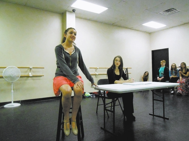 Jessica Ruettiger, 15, rehearses as Maria while Carly Salway, 16, who plays Mother Superior, sits nearby Dec. 3 at Broadway Bound, 1181 S. Buffalo Drive. Broadway Bound and Studio One's Summerli ...