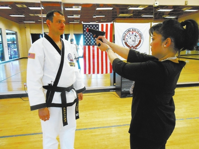 Alan Shaw prepares to disarm student Arlene Bordinhao on Jan. 2 at the City Athletic Club, 7980 W. Sahara Ave. Shaw teaches a Split Second Survival class. (Jan Hogan/View)