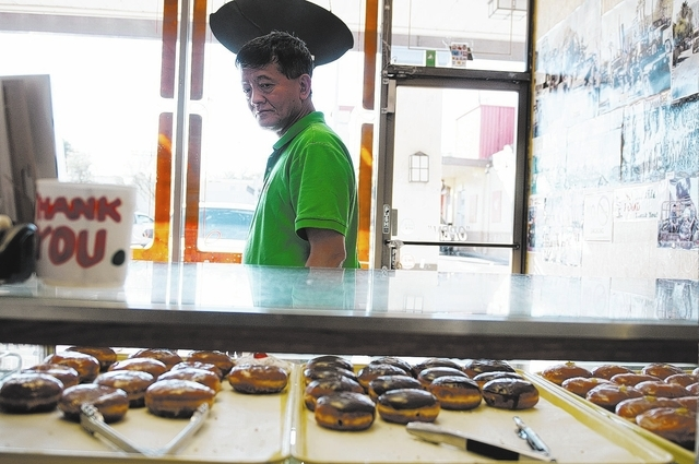 Sothy Seang, owner of Donut Hut, 3242 E. Desert Inn Road, is a 22-year doughnut maker and a survivor of the Cambodian Civil War and the Cambodian Genocide. (Erik Verduzco/View)