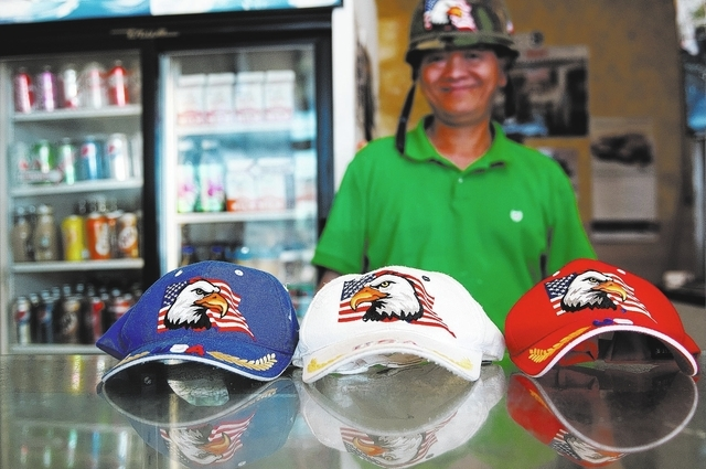 Sothy Seang wears patriotic hats during his workday at Donut Hut, 3242 E. Desert Inn Road. (Erik Verduzco/View)