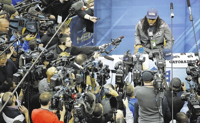 Seattle Seahawks' Richard Sherman answers a question during media day for the NFL Super Bowl XLVIII football game Tuesday, Jan. 28, 2014, in Newark, N.J. (AP Photo/Charlie Riedel)