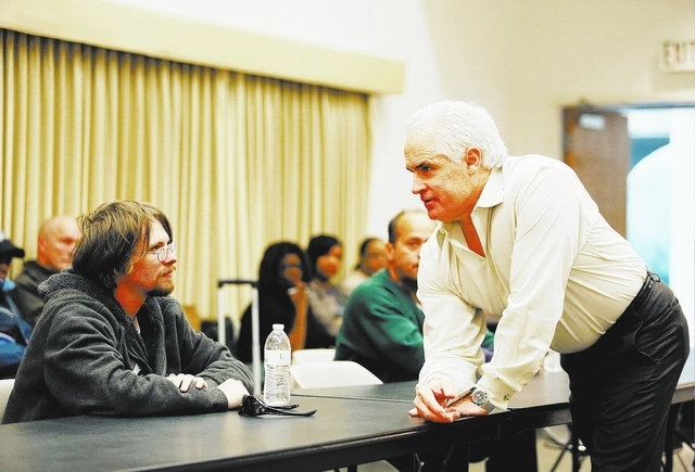 Brian Heinz, left, a homeless young adult, listens to Tiger Todd, right, motivational speaker and founder of Hero School, speak during a Hero School program at Las Vegas Library Saturday, Jan. 11, ...