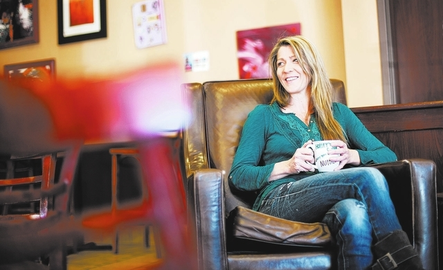Holley Steeley, owner of Holley's Cuppa, relaxes at the coffee shop, 9265 S. Cimarron Road, Dec. 27, 2013. (Chase Stevens/View)