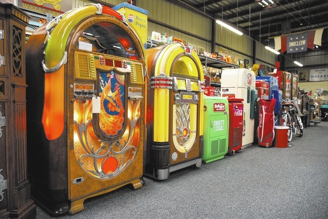 A Wurlitzer (cq) 850 peacock jukebox from 1942, left, is one of 1,200 items up for auction at Victorian Casino Antiques, located at 4520 Arville St., Thursday, Jan. 2, 2014. The 35-year-old busine ...