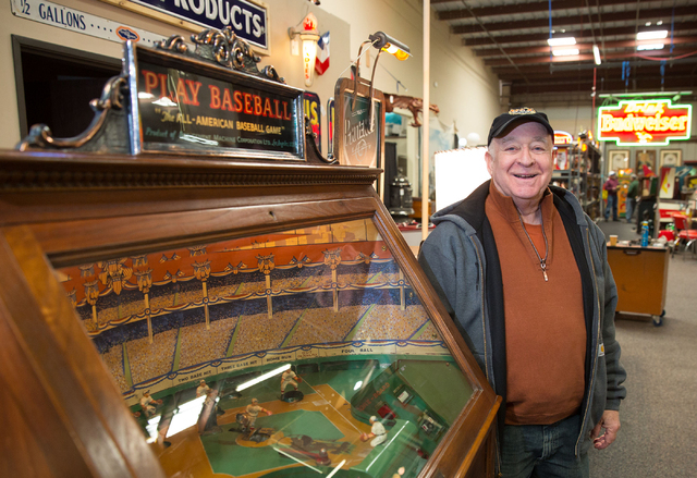 Peter Sidlow poses next to a 1930s baseball game machine at Victorian Casino Antiques, located at 4520 Arville St., Thursday, Jan. 2, 2014. The 35-year-old business is hosting one of its auctions  ...
