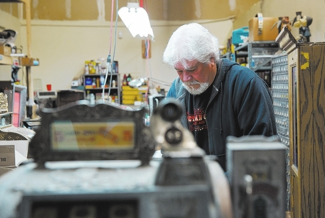 Pat McGuire restores pieces which will be auctioned at Victorian Casino Antiques, located at 4520 Arville St., Thursday, Jan. 2, 2014. The 35-year-old business is hosting one of its auctions Janua ...