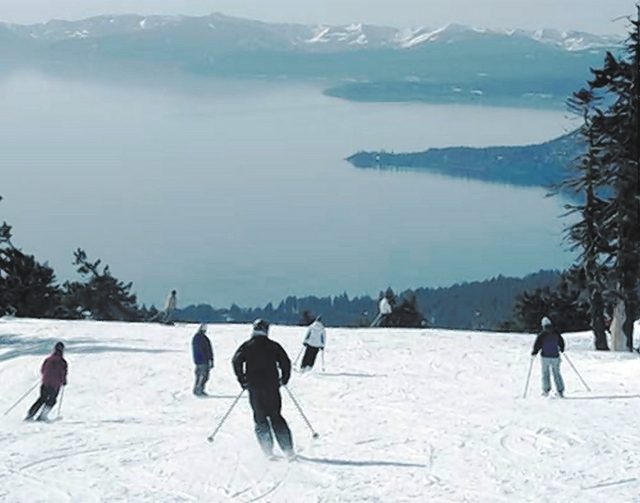 Skiers and snowboarders enjoy the spectacular views of Lake Tahoe during the reopening of Diamond Peak at Incline Village in Lake Tahoe, Nev., Monday, Jan 9, 2006. The resort has been hampered thi ...