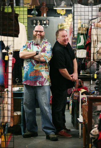 Jason T. Smith, left, and Bryan Goodman stand among merchandise at Sin City Pickers Antique Mall. The duo, which owns a booth at the shop, will make their television debut in the new reality show  ...