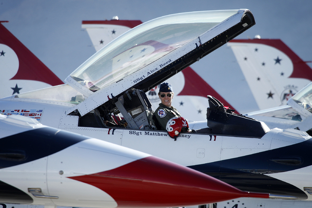 Thunderbird pilot Maj. Caroline Jensen smiles in the cockpit of her plane before taking off at Nellis Air Force Base in Las Vegas Friday, Jan. 10, 2014. Their Air Force demonstration team had thei ...