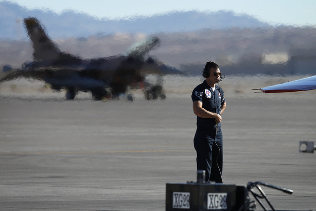 Thunderbird Staff Sgt. William Rotroff, crew chief for Thunderbird One, helps the pilot prepare his plane before taking off at Nellis Air Force Base in Las Vegas Friday, Jan. 10, 2014. Their Air F ...