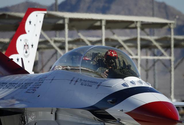 Thunderbird pilot Maj. Michael Fisher taxis his plane before taking off at Nellis Air Force Base in Las Vegas Friday, Jan. 10, 2014. Their Air Force demonstration team had their season cut short l ...