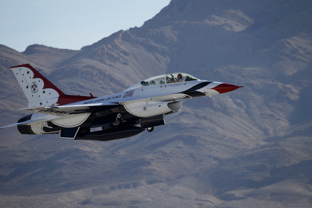 Thunderbird pilot Maj. Michael Fisher takes off at Nellis Air Force Base in Las Vegas Friday, Jan. 10, 2014. Their Air Force demonstration team had their season cut short last year because of budg ...