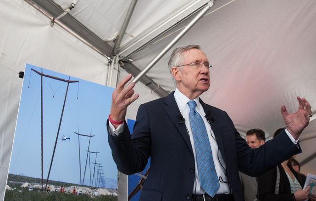 U.S. Sen. Harry Reid, D-Nev., speaks with news media at the One Nevada Transmission Line dedication at the Harry Allen Generating Station, north of Las Vegas, on Thursday. The 231-mile line connec ...