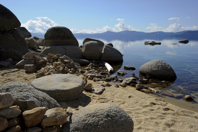 A granite slab that Nevada historians believe was used by Mark Twain as a table for meals and card games, sits on the shore of Lake Tahoe near Incline Village, Nev. The Nevada State Board on Geogr ...