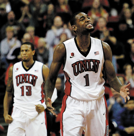 "UNLV forward Roscoe Smith (1), shown Nov. 26 with guard Bryce Dejean-Jones during the Rebels' 61-59 loss to Illinois, called UNLV's loss to Air Force on Saturday ""devastating."" ""But we p ..."