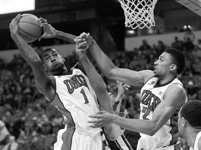 Roscoe Smith, left, of UNLV grabs a rebound in a game against Reno at the Thomas & Mack Center in Las Vegas Wednesday, Jan. 8, 2014. (John Locher/Las Vegas Review-Journal)