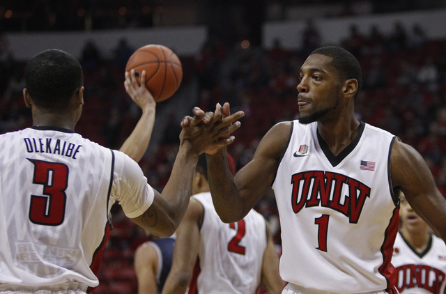 Roscoe Smith, right, of UNLV congratulates Kevin Olekaibe, left, during their game against Reno at the Thomas & Mack Center in Las Vegas Wednesday, Jan. 8, 2014. (John Locher/Las Vegas Review-Journal)