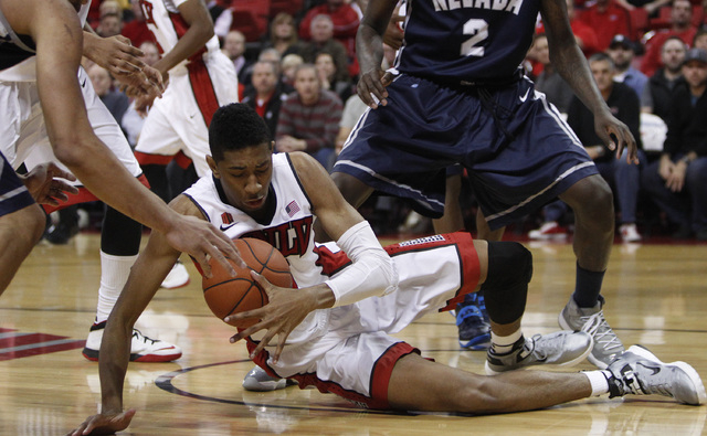 Christian Wood of UNLV grabs a rebound on the ground during a game against Reno at the Thomas & Mack Center in Las Vegas Wednesday, Jan. 8, 2014. (John Locher/Las Vegas Review-Journal)