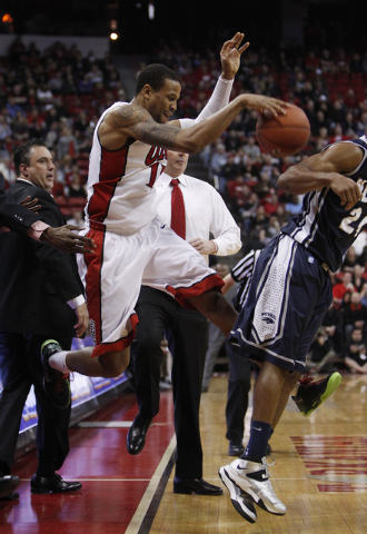 Bryce Dejean-Jones of UNLV keeps the ball from going out of bounds during their game against Reno at the Thomas & Mack Center in Las Vegas Wednesday, Jan. 8, 2014. (John Locher/Las Vegas Review-Jo ...