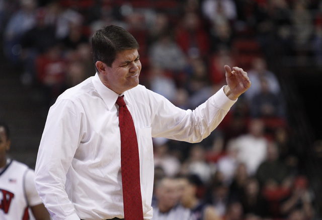 UNLV head coach Dave Rice motions to his players during their game against Reno at the Thomas & Mack Center in Las Vegas Wednesday, Jan. 8, 2014. (John Locher/Las Vegas Review-Journal)