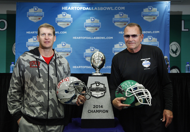 UNLV head coach Bobby Hauck, left, and North Texas head coach Dan McCarney pose for photographers during a press conference at the Cotton Bowl in Dallas Tuesday, Dec. 31, 2013. The two teams will  ...