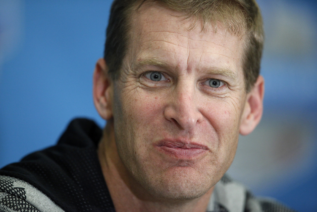 """UNLV coach Bobby Hauck, shown Tuesday at a news conference in Dallas, says the Rebels """"had some really good padded practices"""" in preparation for today's Heart of Dallas Bowl. (John Locher/La ..."""