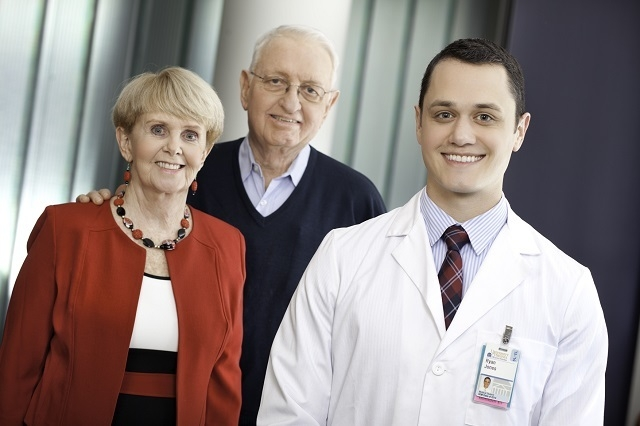 Ryan Jones, right, with Jim and Louise Malloy. During a training session, Jones discovered Jim Malloy had a real -- and potentially deadly -- health condition. (Jackson Smith/UVA Health System)