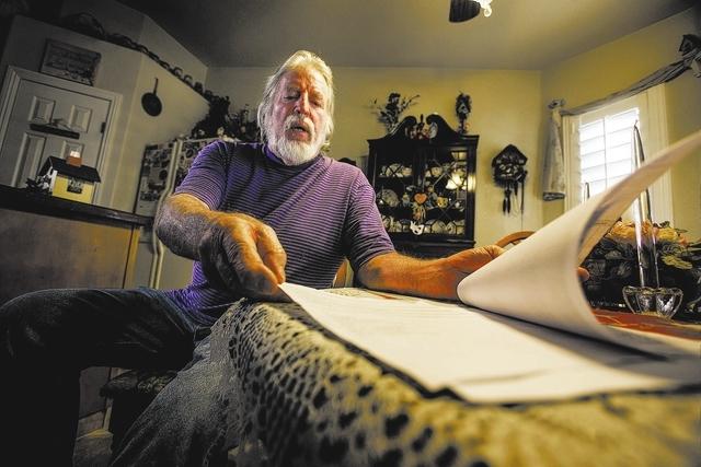 Vietnam combat veteran Kenneth Van Eaton views files from medical records in his northwest Las Vegas home on Monday, Jan. 6, 2014. Van Eaton, 69, waited 11 hours at the North Las Vegas VA Medical  ...