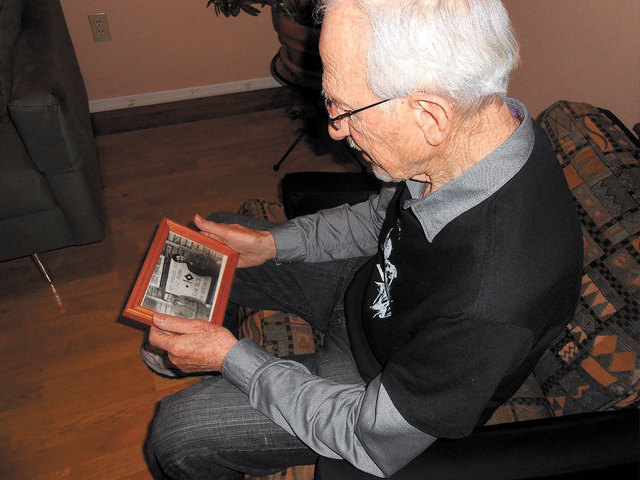Greenspun-Radin Jewish War Veterans Post 21 member Sam Chinkes, 90, holds a photo of himself at age 22 with a friend, Joseph Kaplan, when he was a Technician Fourth Grade in the Army and stationed ...