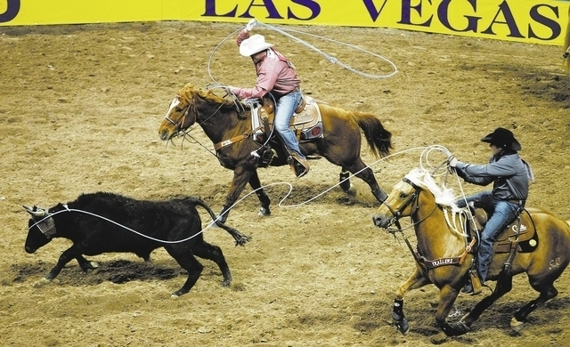 Travis Graves, left, and Kaleb Driggers compete in the team roping event during the National Finals Rodeo in December. NFR will remain in Las Vegas through 2024 after Las Vegas Events and the Prof ...