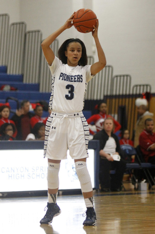 Canyon Springs senior guard Cherise Beynon (3) looks to pass while taking on Valley on Tuesday night. The Pioneers are 73-19 overall and 42-1 in Northwest League play since she joined the program  ...