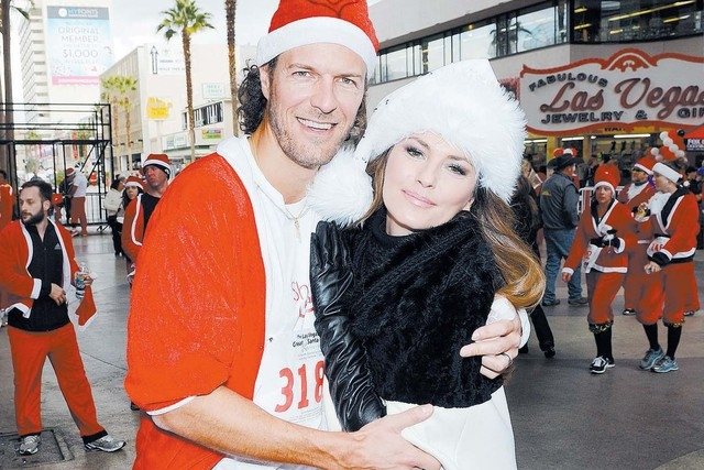 Shania Twain, shown in December with husband Frederic Thiebaud at the finish line of the Ninth annual Opportunity Village Great Santa Run in downtown Las Vegas, starts a new run Wednesday at Ceasa ...