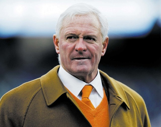 Cleveland Browns owner Jimmy Haslam walks on the field before an NFL football game against the New England Patriots Sunday, Dec. 8, 2013, in Foxborough, Mass. (AP Photo/Steven Senne)