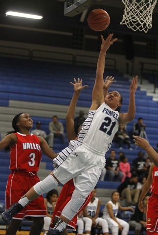 Canyon Springs' Trimece Thomas (21) scores in front of Valley's Alaihya Williams (3) during their girl's basketball game in North Las Vegas on Jan. 28, 2014. (Jason Bean/Las Vegas Review-Journal)