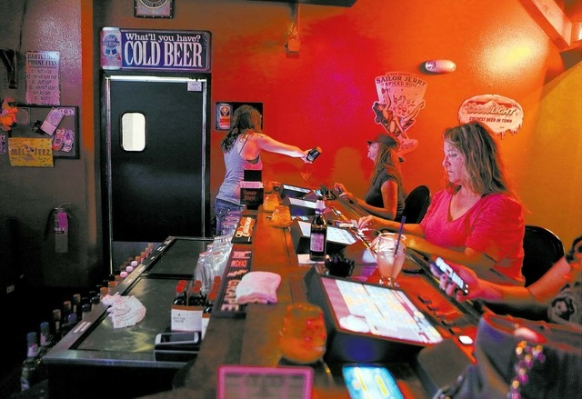 Bartender Sara Pranke, left, pours a drink for a customer at Blind Tiger Thursday, Jan. 16, 2014, in Las Vegas. Blind Tiger, which is located at 6295 S. Pecos Rd., is a neighborhood bar that offer ...