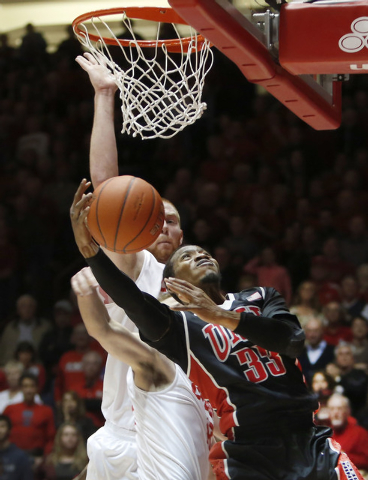 UNLV's Deville Smith (33) tries to score in front of New Mexico's Alex Kirk in the first half of an NCAA college basketball game on Wednesday, Jan. 15, 2014, in Albuquerque, N.M. (AP Photo/Eric Dr ...