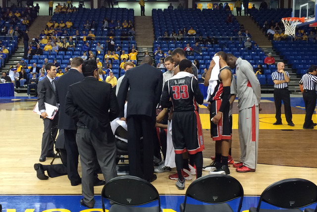 Dave Rice meets with his players as UNLV takes on San Jose State on Wednesday night at The Event Center. (Courtesy Marco Benvenuti)