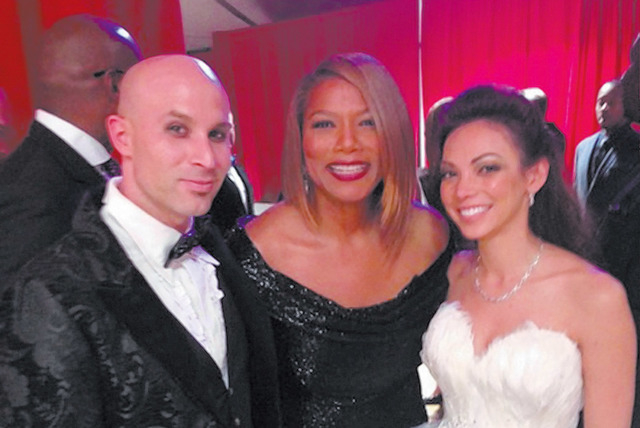 Queen Latifah, center, gets in a wedding photo for magician and entertainer Seth Grabel and Tammy Shaw, publisher of Las Vegas Woman magazine, on Sunday at the Grammy Awards in Los Angeles. (Courtesy)