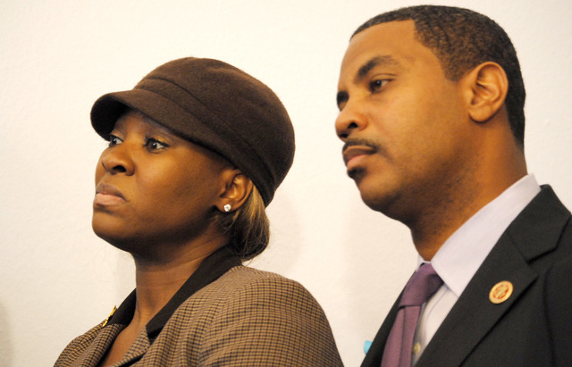 Tamika Woods, left, an unemployed electrical worker from North Las Vegas, prepares to speak at a press conference Tuesday called by Democrats to urge Congress to extend federal jobless benefits on ...
