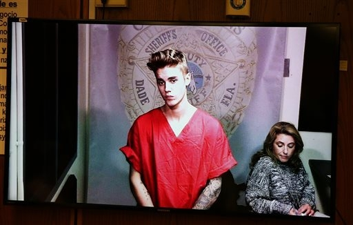 File-This Jan. 23, 2014, file photo shows Justin Bieber appearing in court via video feed in Miami. Video of Bieber at a South Florida police station after his January arrest is expected to be mad ...