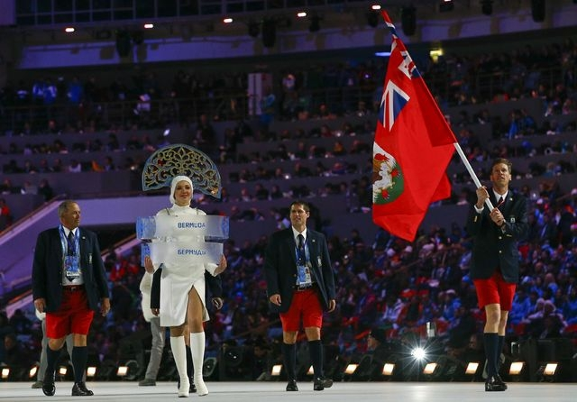 Bermuda's flag-bearer Tucker Murphy leads his country's contingent during the opening ceremony of the 2014 Sochi Winter Olympic Games at Fisht stadium February 7,  2014.        REUTERS/Brian Snyde ...